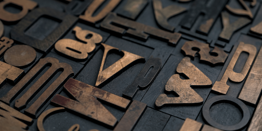 large wooden typeface letters
